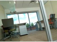 Open door into windowed office